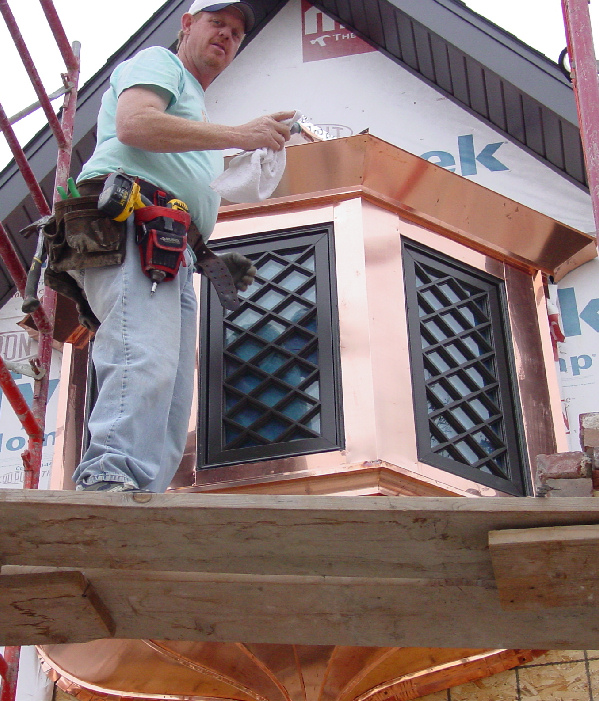 Brett Allen installing a copper bay window, Tulsa, OK